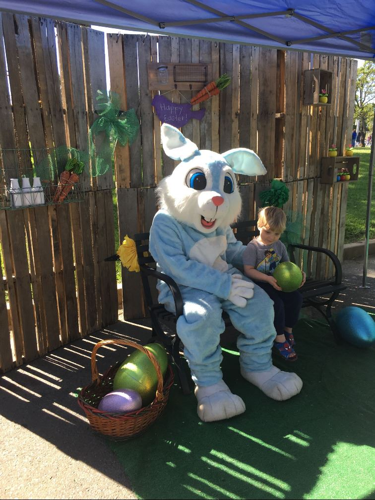Small boy sitting with Easter bunny