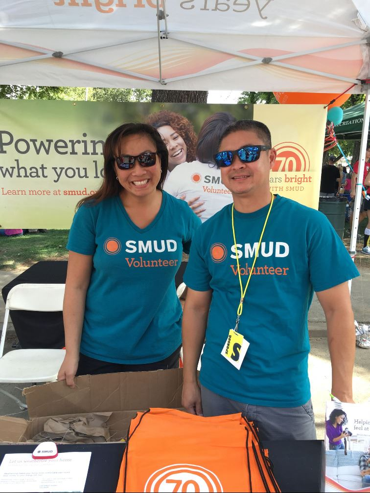 man & woman at SMUD booth