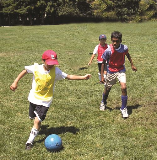 3 boys playing soccer